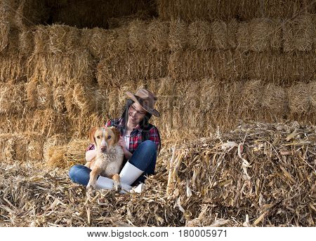 Girl With Dog In Barn