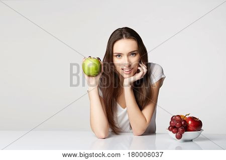 woman girl with fruits basket on gray white background smile happy health care healthy gray closeup beauty apples green red grapes