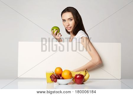 woman girl with fruits basket on gray white background smile happy health care healthy gray closeup beauty orange apple banana juice grapes copy space
