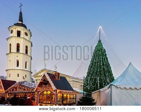 People At Decorated Christmas Tree And Souvenir Xmas Market Vilnius