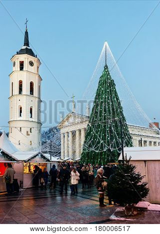 People At Decorated Christmas Tree And Souvenir Xmas Market In Vilnius