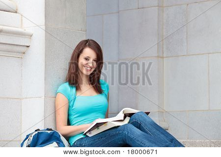 Young woman smiling on college campus
