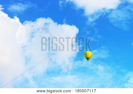 Vilnius Lithuania - September 3 2015: Colorful air ballon flying in the sky Vilnius Lithuania