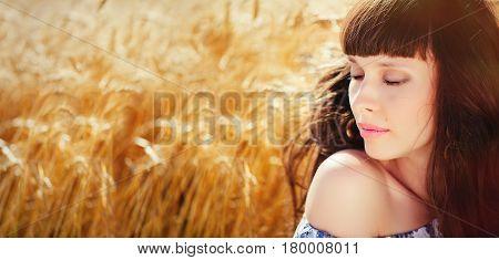 A Field Of Wheat. Beautiful Woman