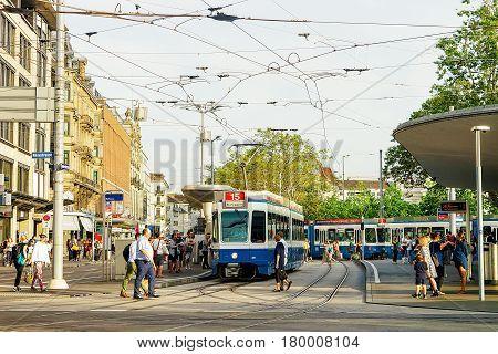 Running Tram At Bus Stop In Zurich City Center