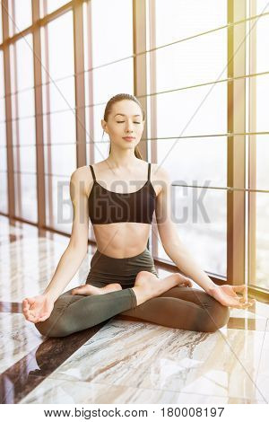 Young Attractive Woman Practicing Yoga, Sitting In Padmasana, Exercise, Lotus Pose, Namaste, Working