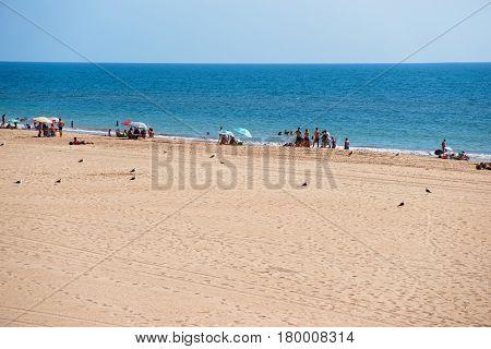 Caleta Beach full of people at Atlantic Ocean in Cadiz Andalusia Spain.