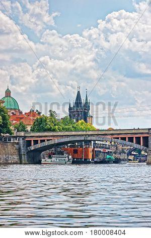 Charles Bridge With Tower Over Vltava River In Prague