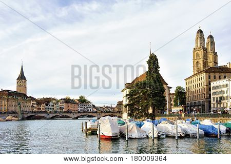 St Peter And Fraumunster Church And Boats Limmat Zurich Switzerland