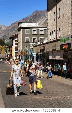 Tourists In City Center Of Zermatt In Summer