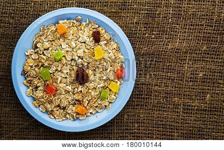 Oatmeal With Dried Fruit (strawberries, Grapes, Kiwi, Peach). Oatmeal On A Wooden Table. Oatmeal Top