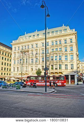 Red Excursion Bus At Sacher Hotel On Albertinaplatz In Vienna