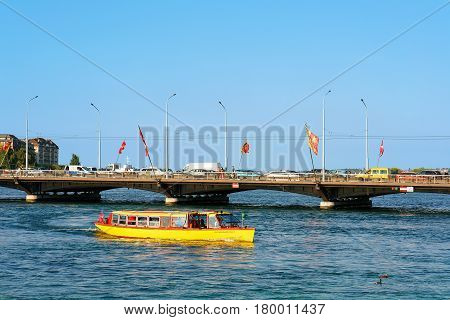 Excursion Ferry In Geneva Lake And Bergues Bridge With Flags