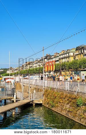 Swiss Flags And Geneva Canton Flags At Geneva Lake