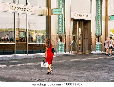 Woman In Red Dress Going To Tiffany Store In Geneva