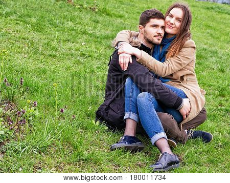 Young Girl Sitting On Boys Lap