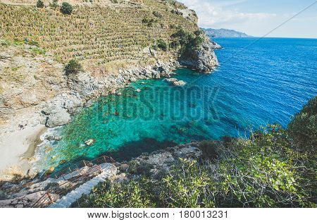Scenic view of beautiful natural sea lagoon with turquoise water down in the rocks at Mediterranean sea coast near Gazipasa town and srairs down, South Mediterranean region of Turkey