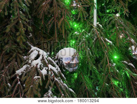 Glittering Christmas Ball On Green Xmas Tree