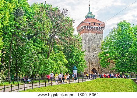 People At Saint Florian Gate In Old Town Of Krakow