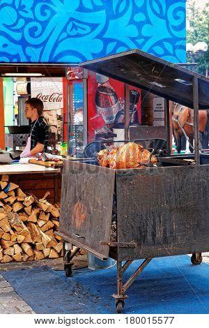 Prague Czech Republic - June 10 2012: Shank cooking booth in Old town of Prague Czech Republic. Chief on the background
