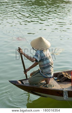 Hoi An Vietnam - February 20 2017 - The boatwoman  on the old national vietnamese boat down the Thu Bong river.