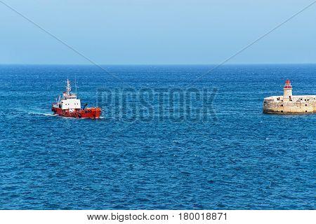 Dry Cargo Carrier At Breakwater At Fort Ricasoli Of Kalkara