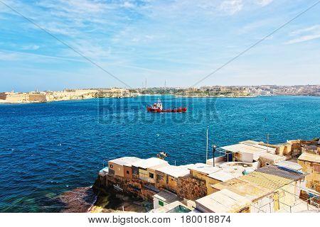 Dry Cargo Vessel And Grand Harbor In Valletta  Malta