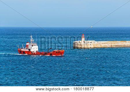 Dry Cargo Vessel And Breakwater At Fort Ricasoli Of Kalkara