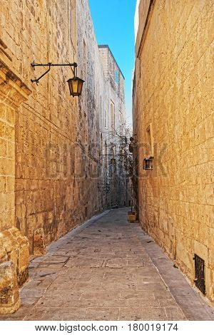 Narrow Silent Street With Lantern Mdina Malta