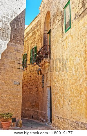 Narrow Silent Street With Lantern And Balcony In Mdina