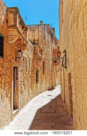 Narrow Silent Street With Lanterns In Mdina