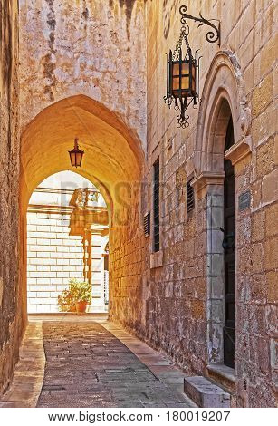 Narrow Silent Street With Vintage Lanterns In Mdina