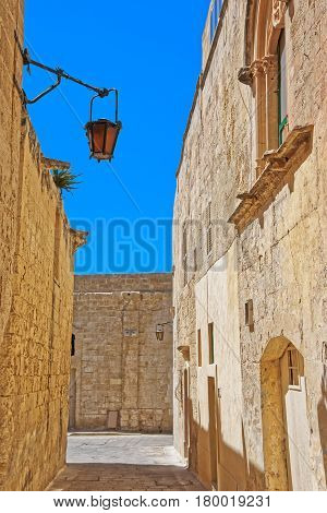Narrow Street With Lantern In Mdina Old Town