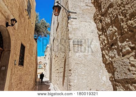 People At Narrow Street With Lantern In Mdina