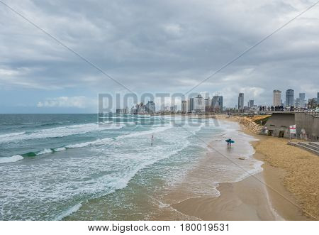 Tel-aviv, Israel - March 03, 2017: View Of The Waterfront With Modern Luxury Hotels, Beach And Surfe