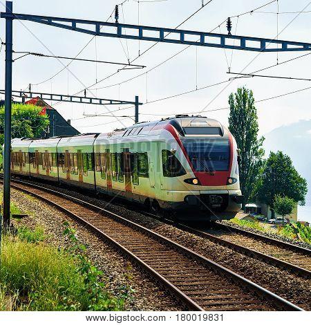 Running Train In Vineyard Terraces Of Lavaux Switzerland