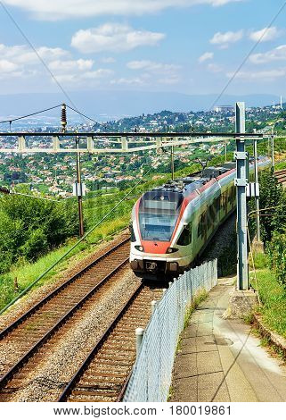 Running Train In Vineyard Terraces Of Lavaux Of Switzerland