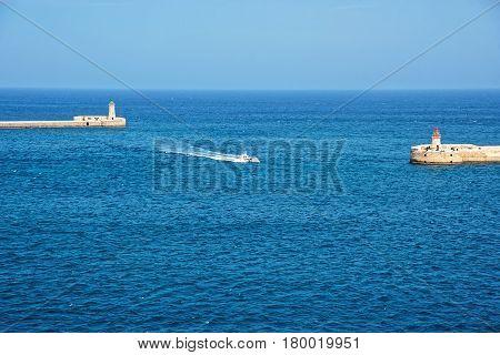 Ship At Breakwaters Of Fort Ricasoli Kalkara And St Elmo