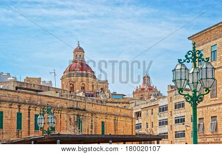 Street And Dome Of Church Of Saint Nicholas In Valletta