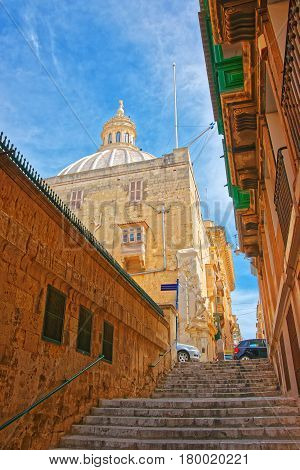 Street With Staircase And Dome Of Carmelite Church At Valletta