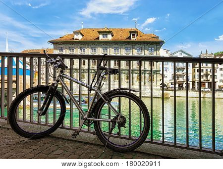 Bicycle At Old Town Hall In River Limmat In Zurich