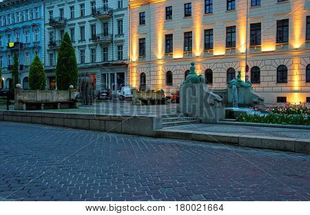 Golem Monument And Kronthal Fountain On Marcinkowski Avenue Evening Poznan