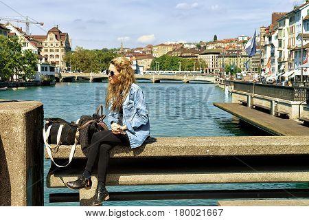 Girl Relaxing At Limmatquai In Zurich Swiss