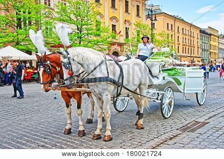 Horse Fiacre And People At Old Town Center Of Krakow