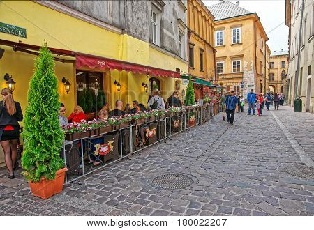 People At Street Restaurant At Old Town Of Krakow