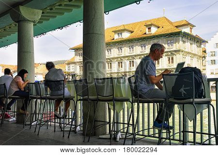 People Relaxing At Old Town Hall At Limmat Zurich Swiss
