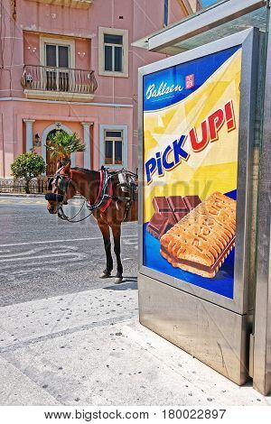 Valletta Malta - April 3 2014: Horse coach standing at the bus stop in Valletta old town Malta