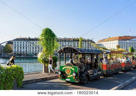 People In Excursion Tram At Promenade Of Geneva Lake Summer