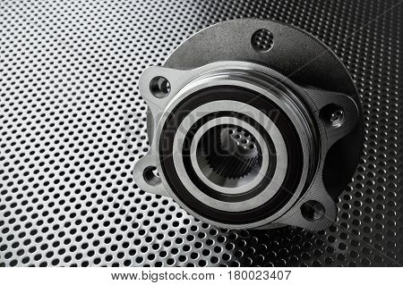 Composition of the car wheel bearing on metal surface. Selective focus