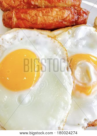Low carb breakfast with fried eggs and sausage